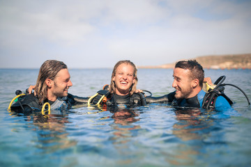 Foto op Canvas Duiken Scuba divers enjoying their excursion in the sea