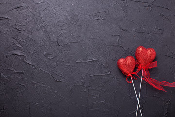 Hearts on  textured black background