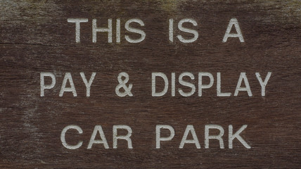 white letter Pay and Display car parking sign
