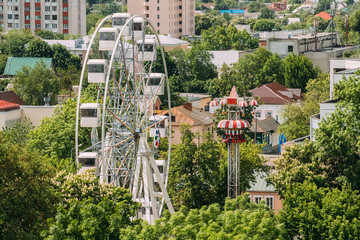 Gomel Belarus. Top View Of Ferris Wheel Among Green Crowns, Buildings