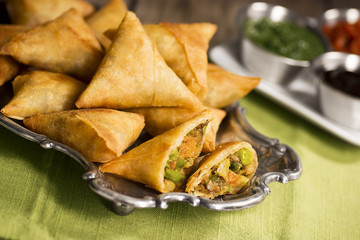 Vegetarian Samosas with Dipping Sauces and Chutneys