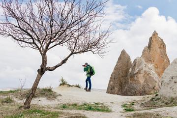 taking photos of rocky mountain landscape in Cappadocia