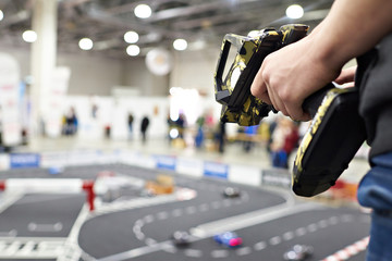 Hand with radio control and competition for model cars
