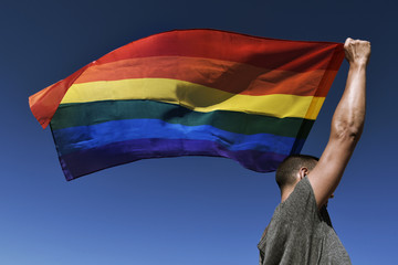 man with a rainbow flag