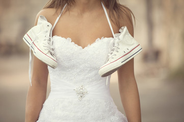 Beautiful bride outdoors , wedding sneakers