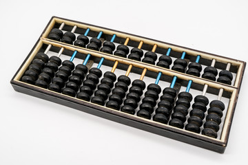 Antique abacus on white