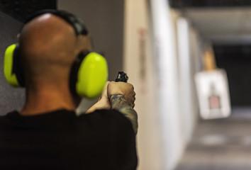 Man shooting gun at shooting range