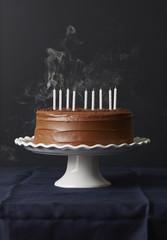 Birthday chocolate cake isolated on black background