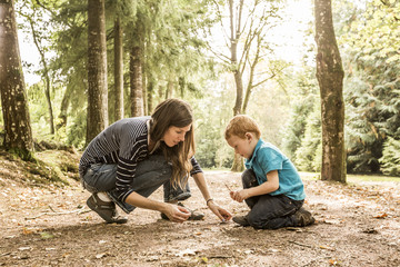 Mother playing with son (2-3) in park