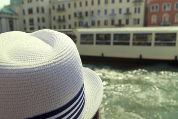 Tourist with a cap looking at ferry boat in Venice, Italy. Background for travel agency or advertising.