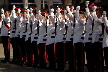 Members of the Royal Gibraltar Regiment salute during a parade to celebrate the 91st birthday of Britain's Queen Elizabeth at Grand Casemates Square, in the British overseas territory of Gibraltar