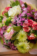 a bright bouquet of spring flowers in the interior