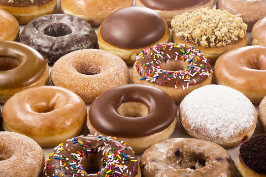 Background of Assorted Donuts (Doughnuts) of Various Flavors