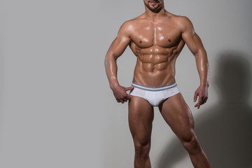 man with muscular body in underwear pants