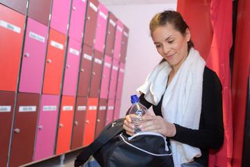 woman in the sports locker room
