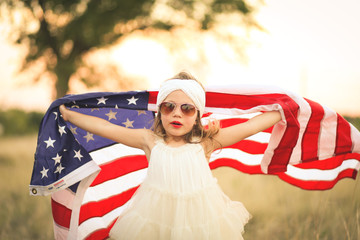 Adorable patriotic girl with american flag