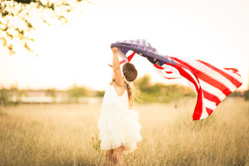 Adorable patriotic girl with american flag Wall mural
