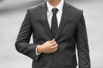 Closeup of man wearing suit and tie.