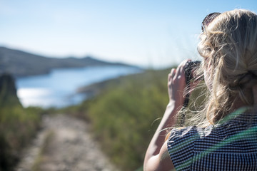 Young woman with camera, Symbol photographing woman, Emotive pictures of beautiful women on vacation, Detail of young blonde woman with camera in wild