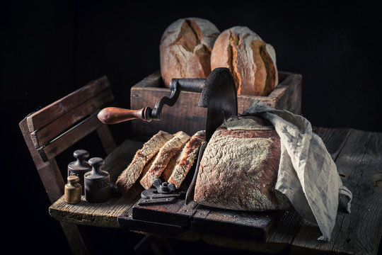 Big loaf of bread on old wooden table