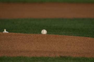 Stock photo of a baseball on the pitchers mound.