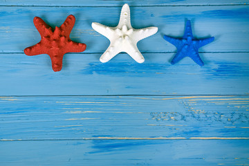 red white and blue starfish on nautical blue rustic wood
