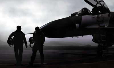 Fighter pilot with supersonic jet on military airbase at dawn