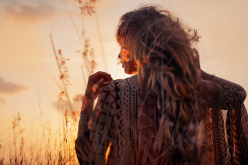 close up of beautiful young woman at sunset