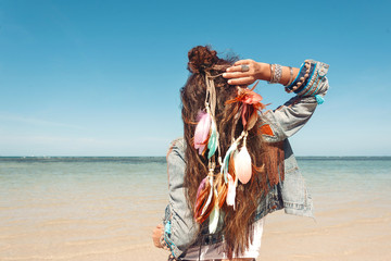 stylish young woman in denim jacket on the beach