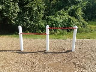 white and red bars on playground