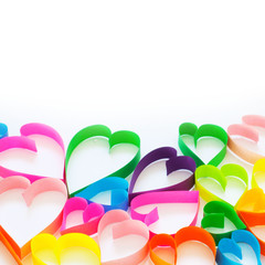 Bright colored hearts made of paper. White background.