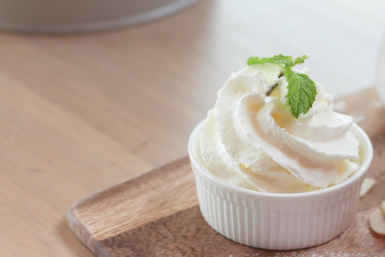 Whipped cream in ceramic cup