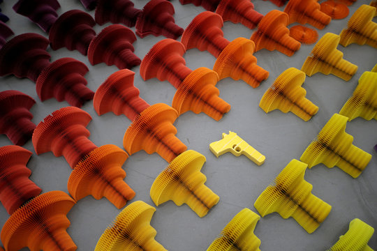 "Paper sculptures in the shape of handgun are seen as a part of Chinese artist Li Hongbo's work ""Ocean of Flowers"" in Beijing"
