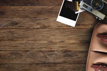 Hipster freelance photographic equipment on a wooden desktop.