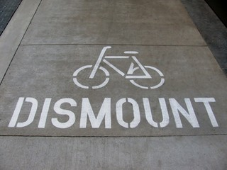 Cyclist dismount road sign
