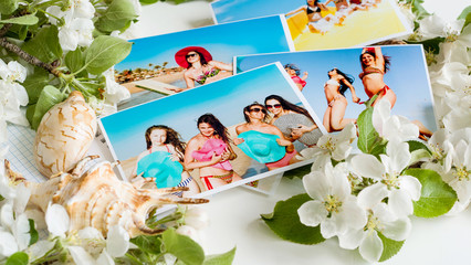 Photo album from photos of young girls in bathing suits on the table