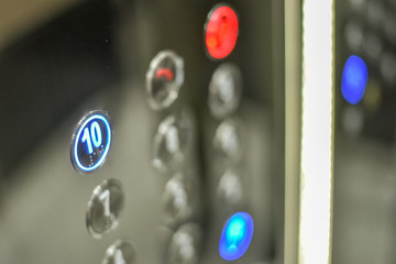 Elevator interior with modern design and pressing elevator buttons