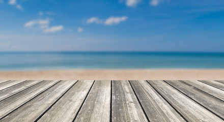 Wood table top and blurred summer blue sea and sky background. - can used for display or montage your products.