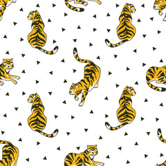 Vector seamless pattern with tigers and triangles isolated on the white background. Animal  background for fabric or wallpaper boho design.