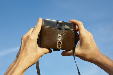 Taking pictures with a vintage film camera. Outdoor photography