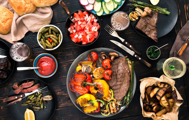 Grilled steak with grilled vegetables, beer and wine