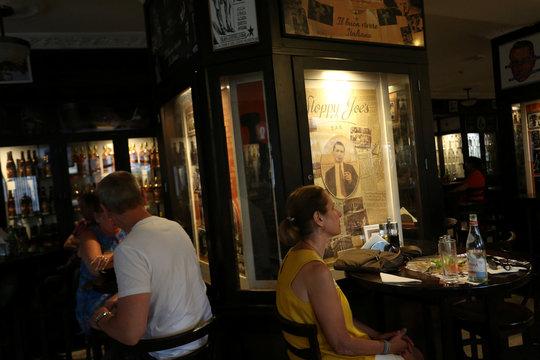 People sit at Sloppy Joe's eatery in Havana