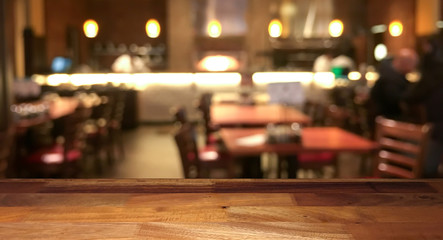 Door stickers Restaurant Empty wooden table top with blurred restaurant on background