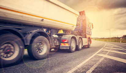 truck on asphalt road. lorry delivering cargo Wall mural