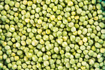 Flat lay raw green peas abstract background
