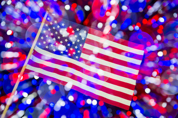 American flag multiple exposure background in abstract night view with colorful bokeh lights