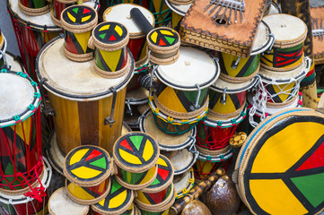 Afro-Brazilian drums and musical instruments stacked up in historic tourist district of Pelourinho, Salvador, Brazil.