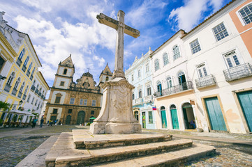 Bright view of Pelourinho in Salvador, Brazil, dominated by the large colonial Sao Francisco Christian stone cross in the Anchieta Plaza