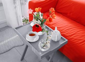 Interior of modern veranda with beautiful flowers on table