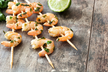 Shrimp skewers on wooden table